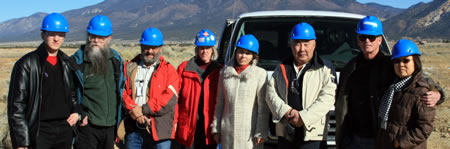 The Open World Delegation and Molycorp staff at the Molycorp Mill Tailings Pile above Questa, New Mexico. (L to R): Anton Ulatov, Misha Jones (Pacific Environment), Paul Robinson (SRIC), Anne Wagner (Molycorp), Albina Morilova, Petr Nokhoev, Taylor Streit (Red River fishing guide), Tamara Troyakova.